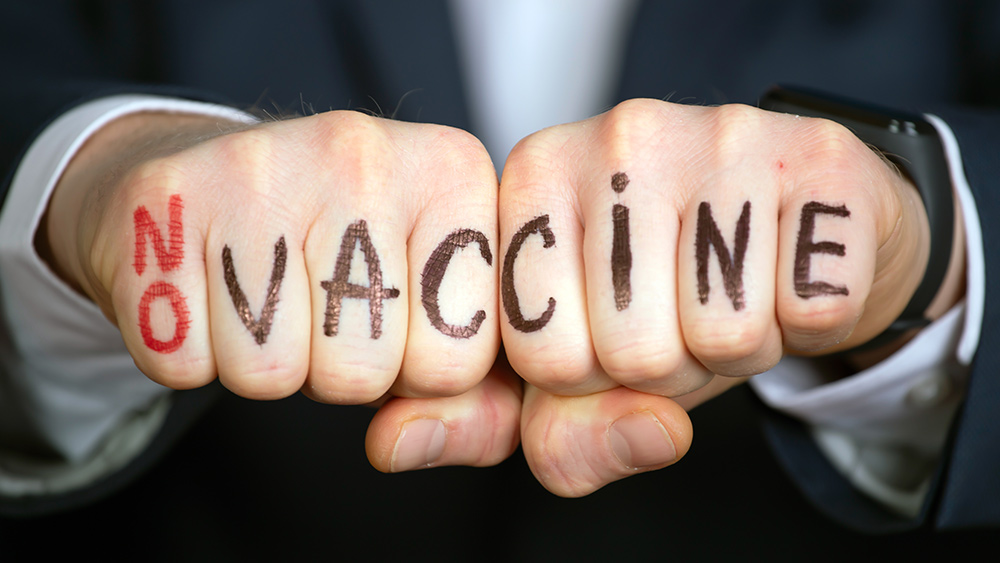 Image: Medical staff shortages feared in France as health care workers balk at COVID-19 vaccine mandates